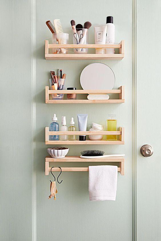 Bathroom storage behind door shelves