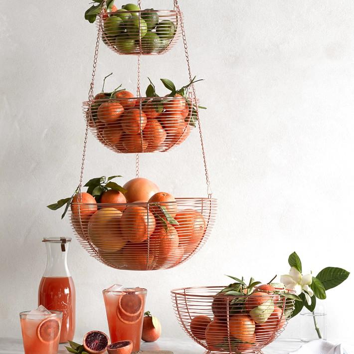 Kitchen organizing hanging fruit basket