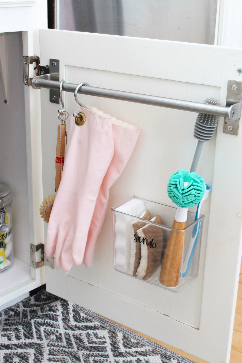 Under-kitchen-sink-door-organizers-towel-bar